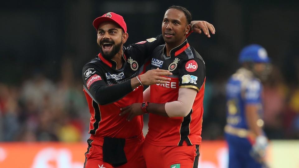 Samuel Badree (right) celebrates with Royal Challengers Bangalore captain Virat Kohli after taking a hat-trick against Mumbai Indians in an Indian Premier League (IPL) 2017 match.