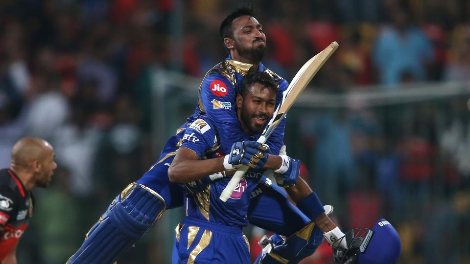 Krunal Pandya and Hardik Pandya in a perfect family moment as the brothers guided Mumbai Indians to a four-wicket win against Royal Challengers Bangalore in their 2017 Indian Premier League match at the M Chinnaswamy Stadium in Bangalore on Friday.  (BCCI)