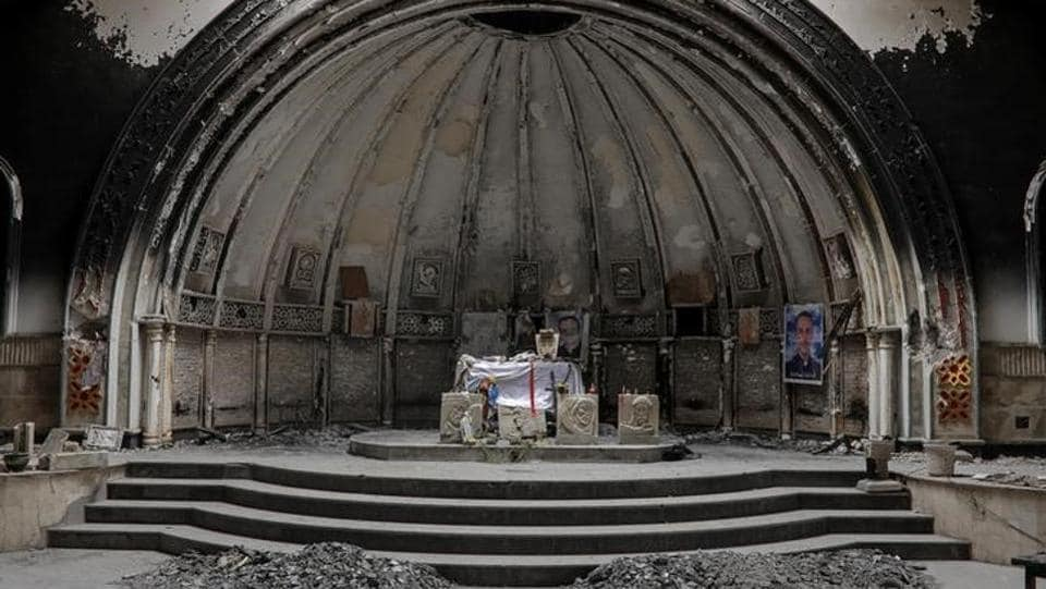 An altar of a damaged church is seen in the town of Qaraqosh, south of Mosul, Iraq. With Islamic State expelled, Iraqi Christians are trickling back to the ransacked town of Qaraqosh, beset by anxiety for their security and yet hopeful they can live in friendship with Muslims of all persuasions. (Marko Djurica/Reuters)