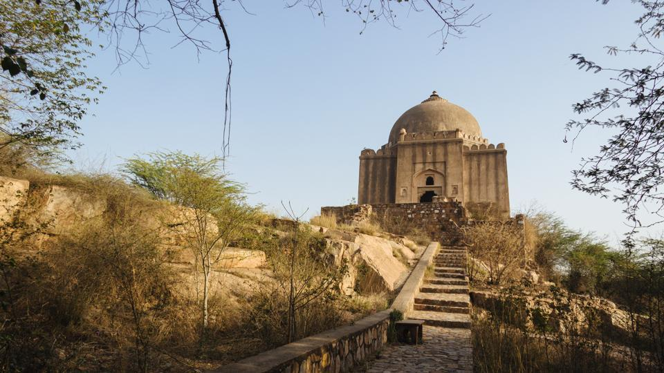 Azim Khan's Tomb was built in the the 17th century by the later Mughals and is located near the intersection of Mehraulli-Badarpur road and Anurvat road. Being placed a top a rock hill gives this monument a very prominent appearance making it almost symbolic of this area in South Delhi yet its history is not well known. (Vageesh Lall/HT Photo)