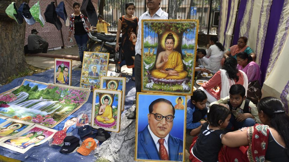 People buy posters and souvenirs in tribute of Dr Bhim Rao Ambedkar at Parliament Street in New Delhi.