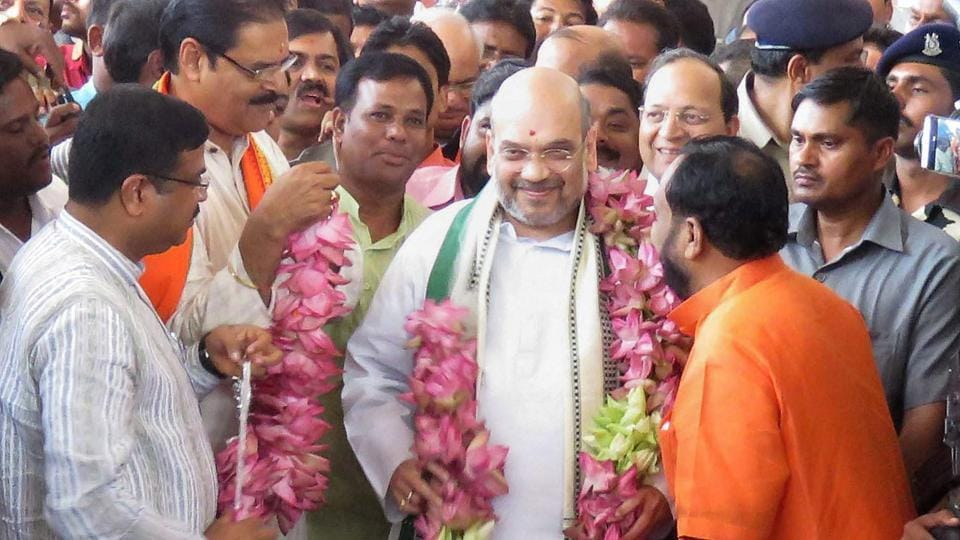 Odisha BJP president Basanta Panda and senior leader KV Singhdeo welcome party national president Amit Shah on his arrival at the airport in Bhubaneswar on Friday.