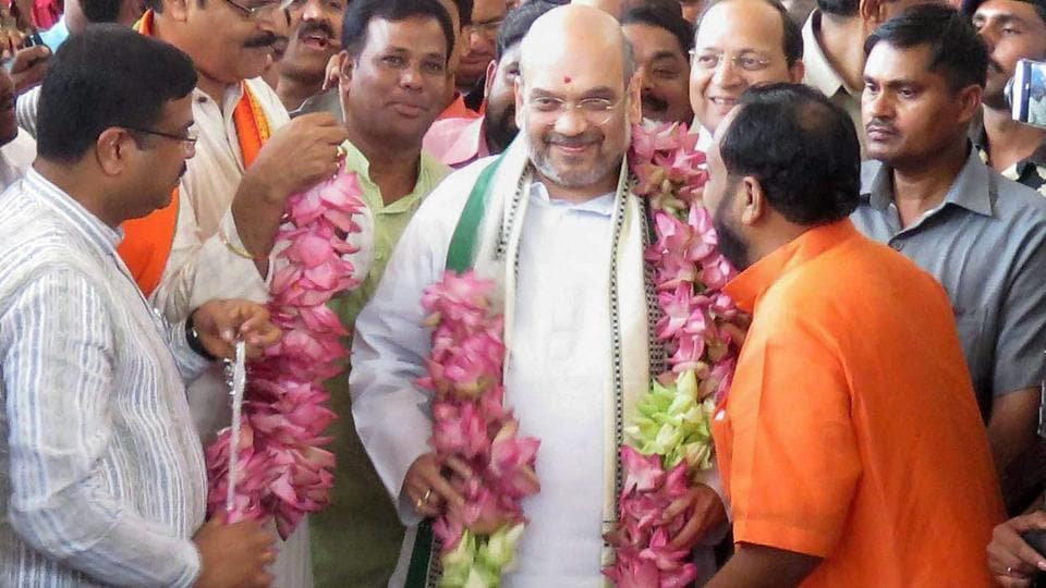 Odisha BJP president Basanta Panda and senior leader KV Singhdeo welcome Amit Shah with a garland of 74 lotuses on his arrival at the airport in Bhubaneswar.
