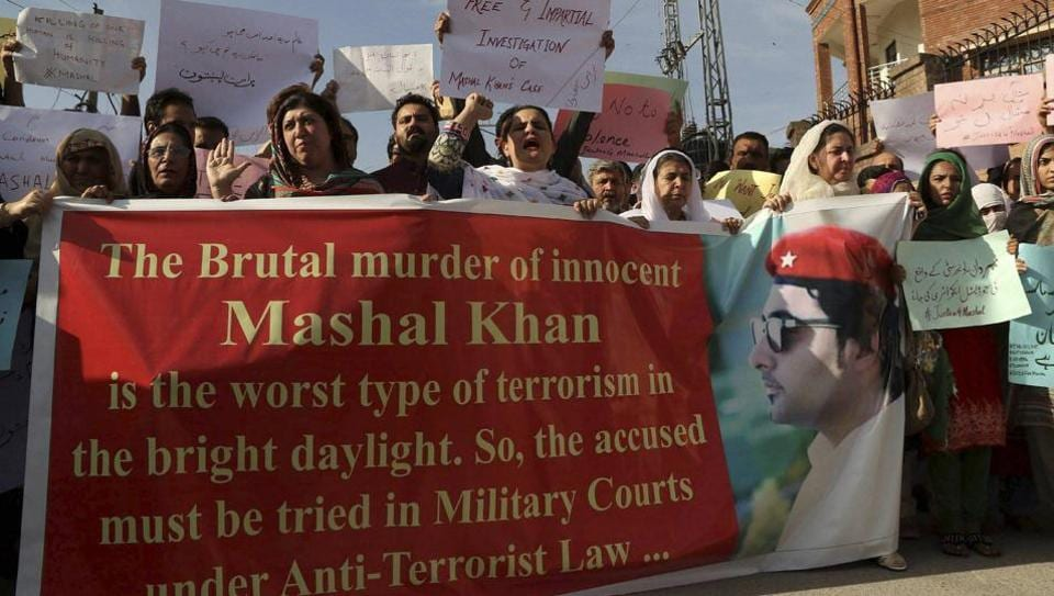 Activists of a Pakistani civil society protest against the killing of a student Mohammad Mashal in Peshawar, Pakistan, Friday, April. 14, 2017.