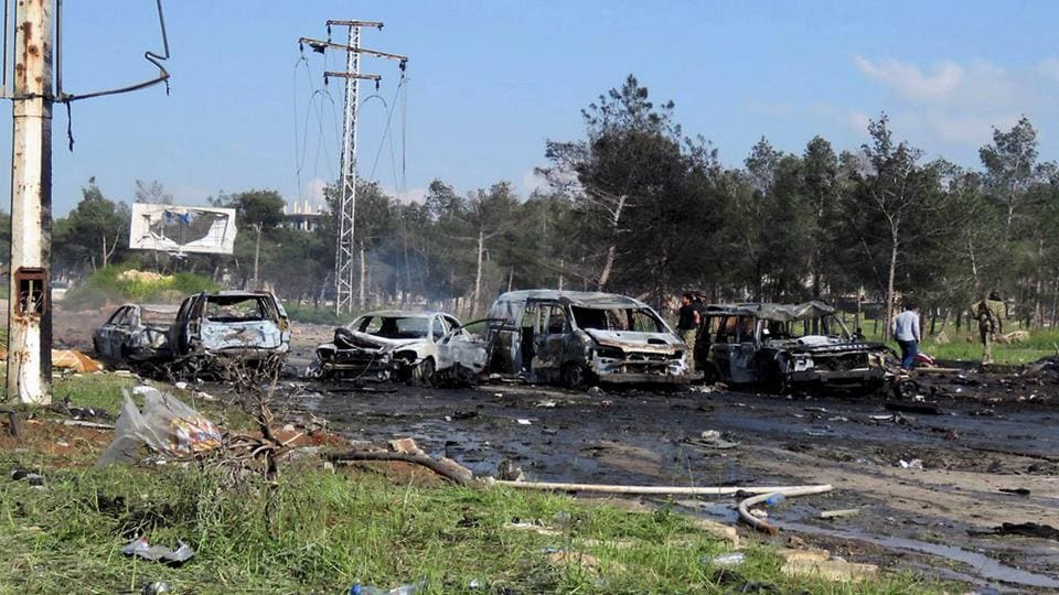 Image released by the Thiqa News Agency shows charred and damaged cars at the scene of an explosion in the Rashideen area, a rebel-controlled district outside Aleppo city, Syria, on April. 15, 2017.