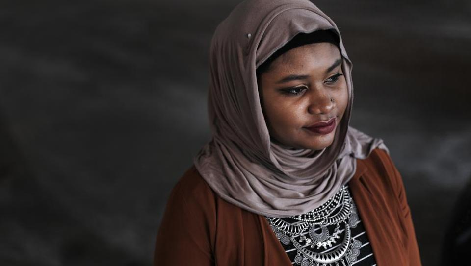 Fatimah Farooq is shown, Tuesday, March 14, 2017 in Ann Arbor, Mich. Farooq counsels refugees from places like Iraq and Syria, who have been victims of trauma, torture or sex trafficking.