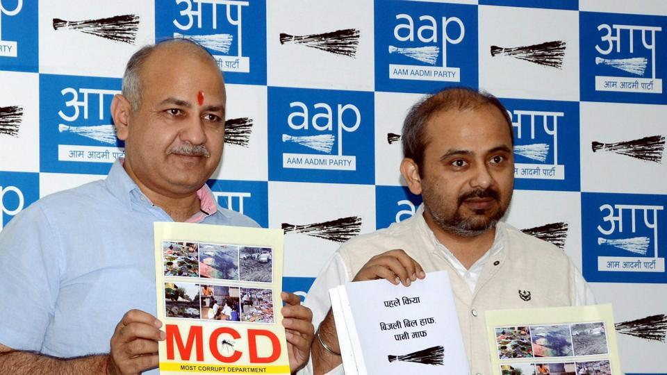 Deputy Chief Minister of Delhi Manish Sisodia and partyman Dilip Pandey  during a press conference in New Delhi on Saturday.