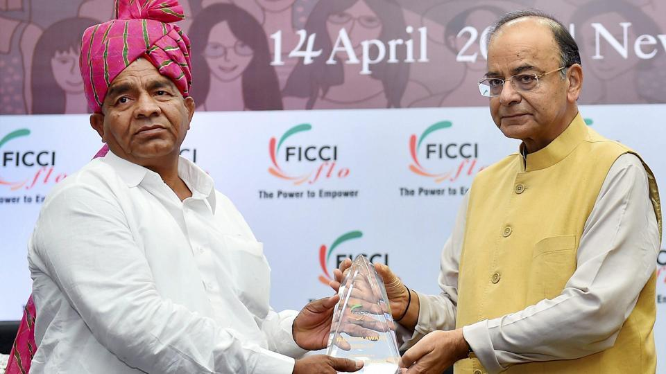 Union Minister for Finance, Corporate Affairs and Defence Arun Jaitley present ICON award to Wrestler Mahavir Singh Phogat during the 33rd Annual Session of FICCI Ladies Organisation (FLO) in New Delhi on Friday.