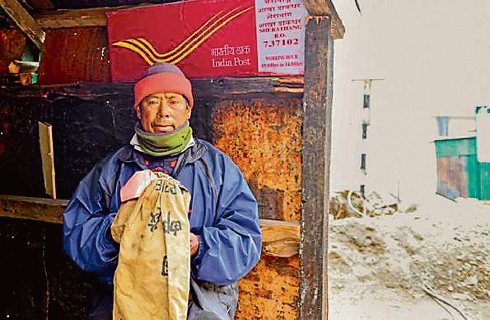 Postman Bhim Bahadur Tamang at the Sherathang border post. Tamang trudges through snow once a week to deliver mail across the Nathu La pass in Sikkim.