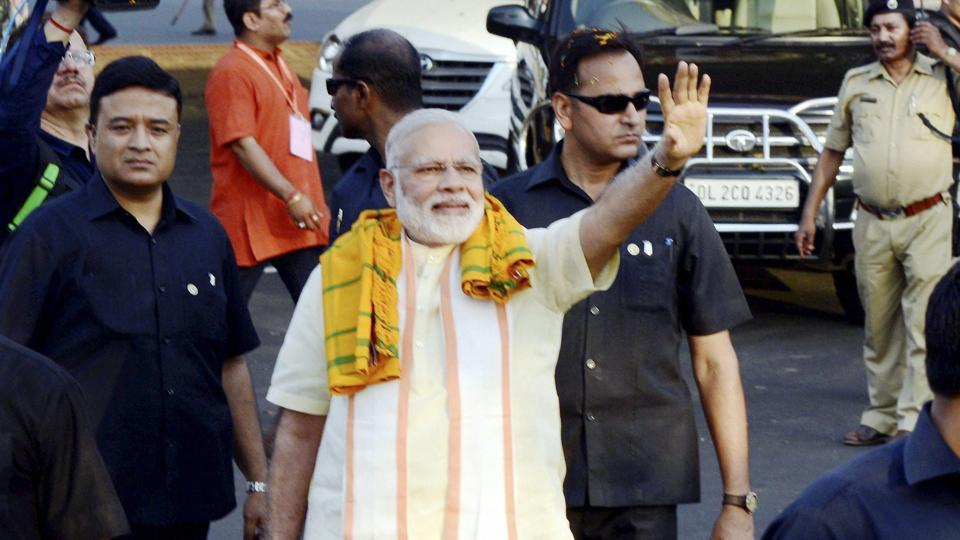 Prime Minister Narendra Modi waves to supporters at Bhubaneswar airport on Saturday. He will be leading a roadshow in Surat as part of a two-day visit to Gujarat starting Sunday.