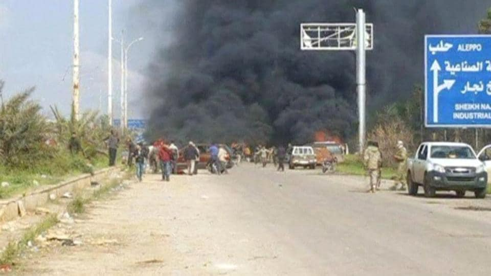 Still image shows a cloud of black smoke rising from vehicles in the distance in what is said to be Aleppo's outskirts.