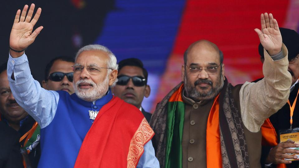Prime Minister Narendra Modi and BJPnational president Amit Shah wave to supporters in New Delhi in January 2015.