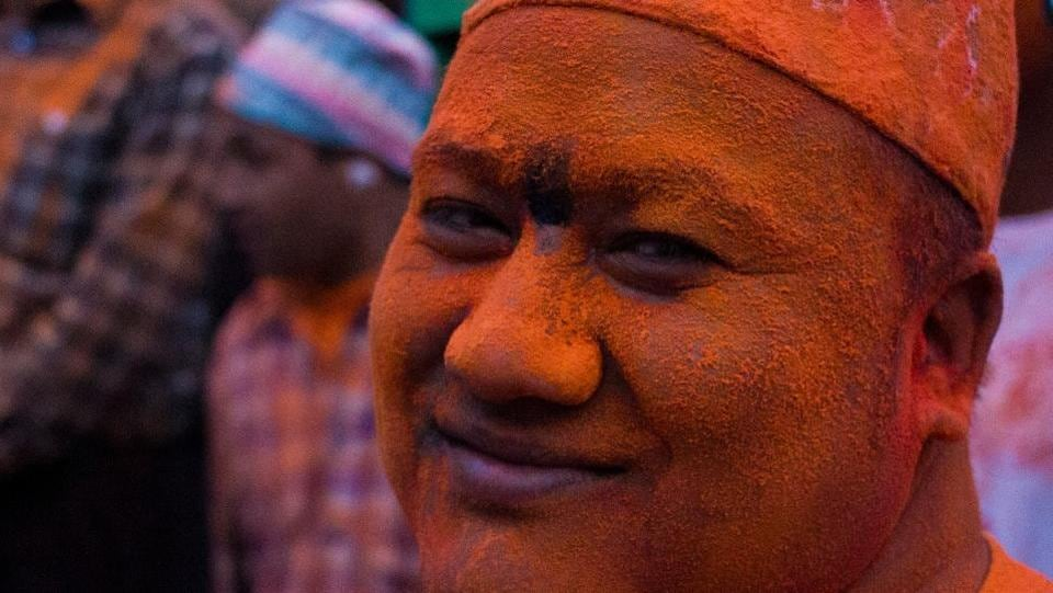 A local's face is covered in colourful powder as they mark the beginning of new yera. (Photo By Nipun Prabhakar)