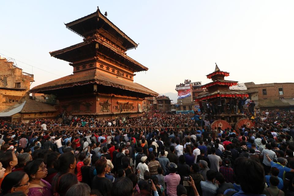 Nyatapola Temple with an architecture that echoes the Himalayas seen here brimming up with people. The 30 meter high, five storied temple built in 1702 is still one of the tallest structures in the Kathmandu Valley and the centre for the Bisket Jatra. (Photo By Nipun Prabhakar)