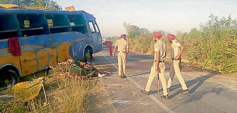 Cops at the accident spot on Pathankot-Jalandhar highway on Sunday.