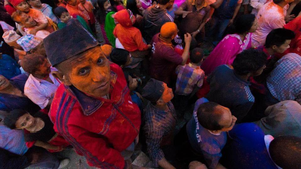 Nepalese people seen in  red and orange  as vermillion powder was thrown in all directions for the Sindoor Jatra festival which is part of the week-long Bisket Jatra festival. (Photo By Nipun Prabhakar)