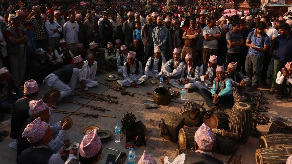 A group of musician gather among the crowd at the  Nyatapola temple to fill its massive courtyard with the sounds of devotion. (Photo By Nipun Prabhakar)