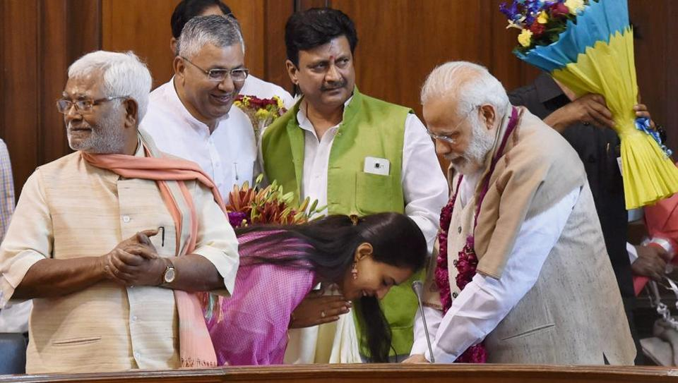 New Delhi: Prime Minister Narendra Modi being greeted by BJP MP Pritam Munde at a function organised at Parliament in New Delhi on Wednesday to thank him for passage of the OBC bill in Lok Sabha which accords constitutional status to the National Commission for Backward Classes (NCBCs).