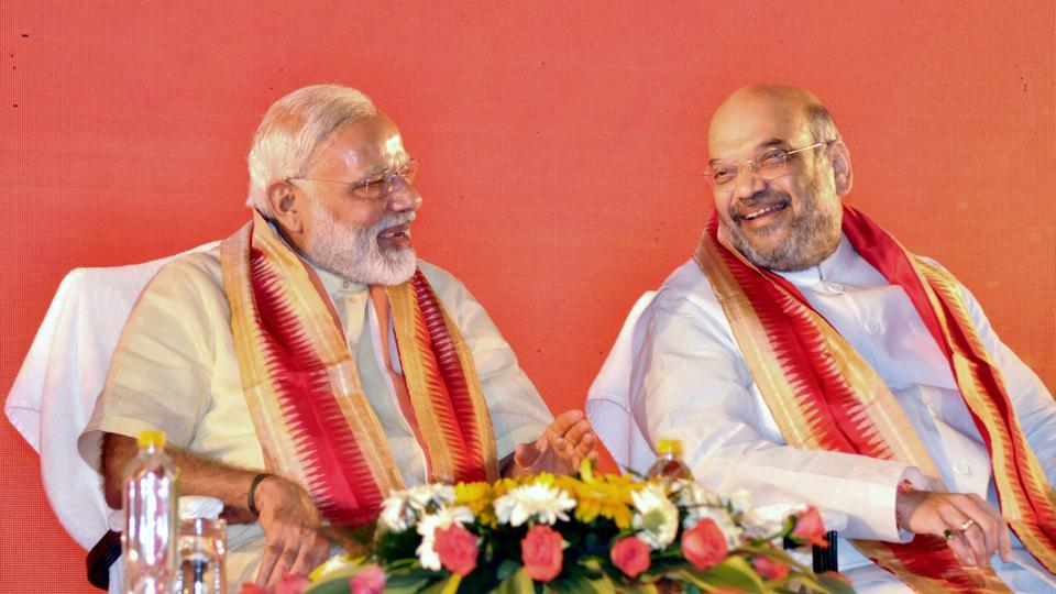 Prime Minister Narendra Modi shares a lighter moment with BJP president Amit Shah during the party's National Executive meet in Bhubaneswar on Saturday.
