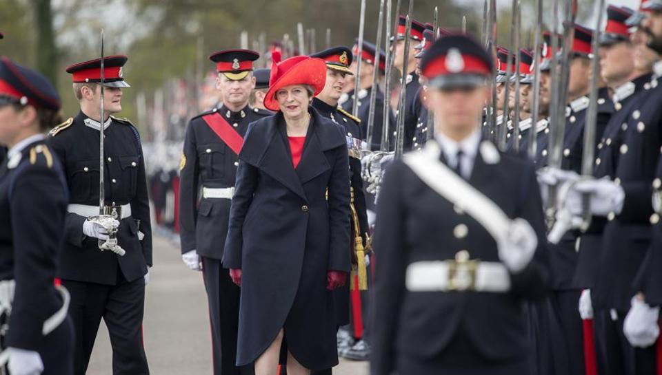 That didn't go well: British Prime Minister Theresa May, representing Britain's Queen Elizabeth II, views the cadets during the Sovereign's Parade at the Royal Military Academy, Sandhurst, southwest of London on April 13.