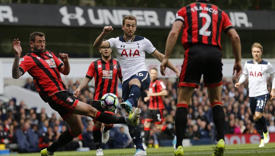 Tottenham Hotspur's Harry Kane shoots on goal against Bournemouth in an English Premier League match.