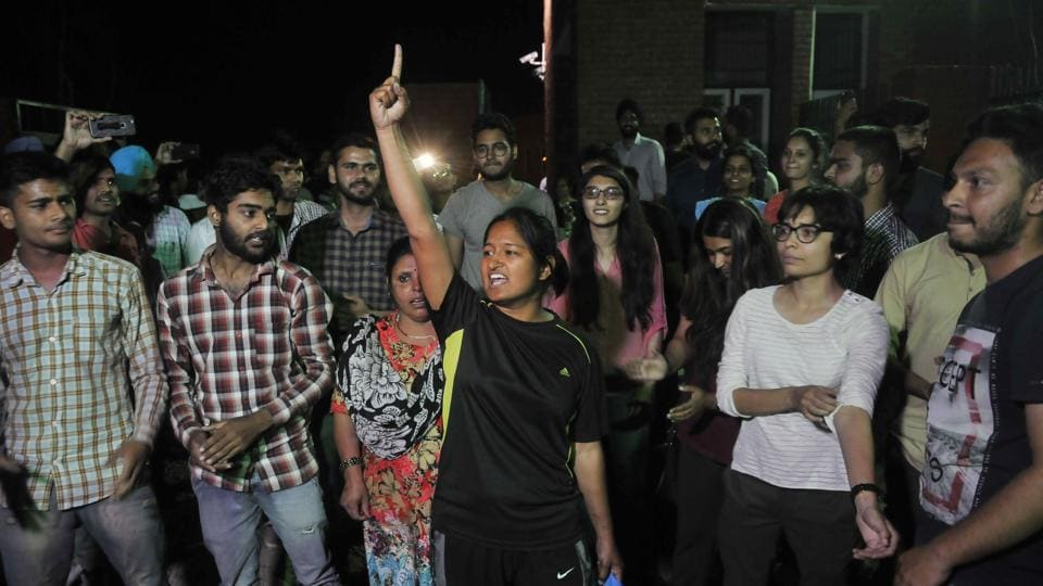 Some of the released students with their friends and supporters outside Burail Jail in Chandigarh on Saturday night.