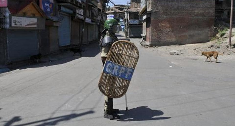 A paramilitary soldier stands guard during curfew in Srinagar on July 20, 2016.