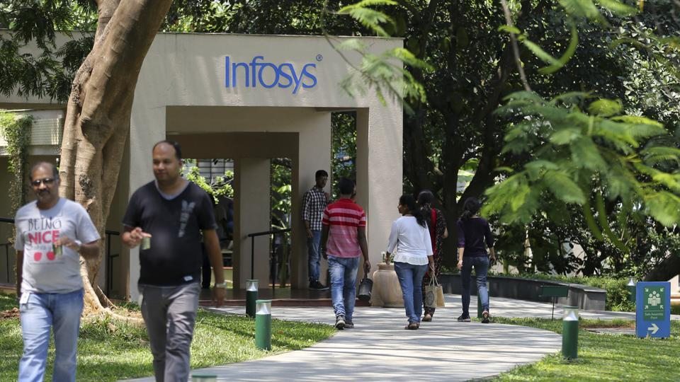 Infosys employees walk inside the company headquarters during a break after their annual financial results were announced in Bangalore on April 13.