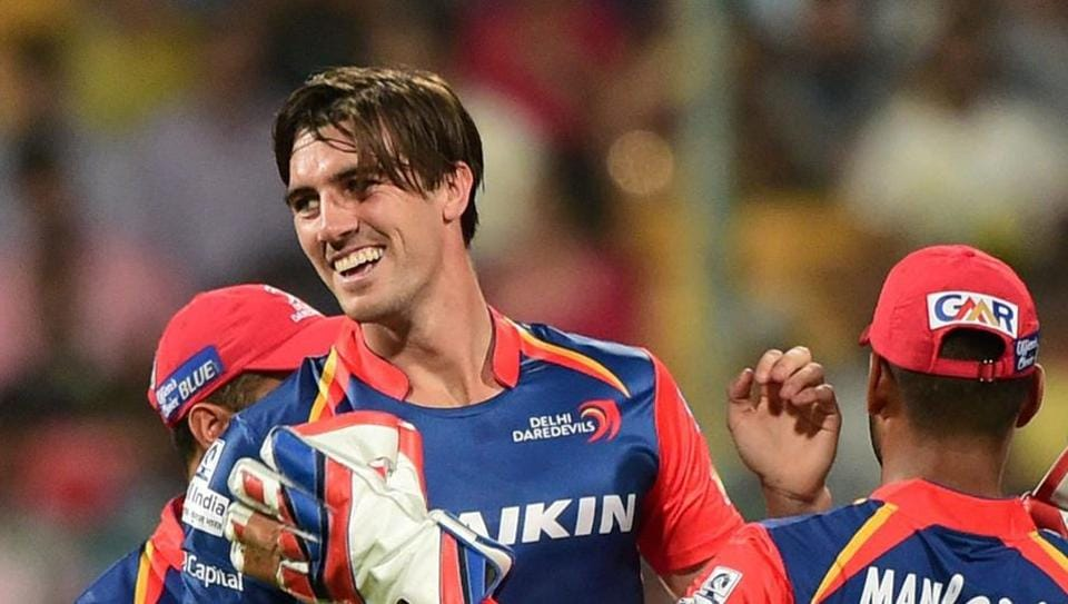 Delhi Daredevils pacer Pat Cummins celebrates with teammates the wicket of Royal Challengers Bangalore's Mandeep Singh during their 2017 Indian Premier League (IPL) match at the Chinnaswamy stadium in Bengaluru.
