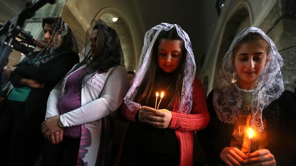 Iraqi Christian attend an Easter mass at the Mar Shimoni church in the town of Bartalla near Mosul, on April 15, 2017.
