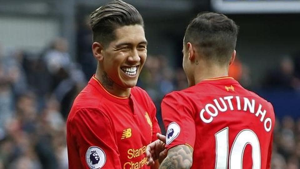 Liverpool's Roberto Firmino celebrates scoring their first goal against West Bromwich Albion.