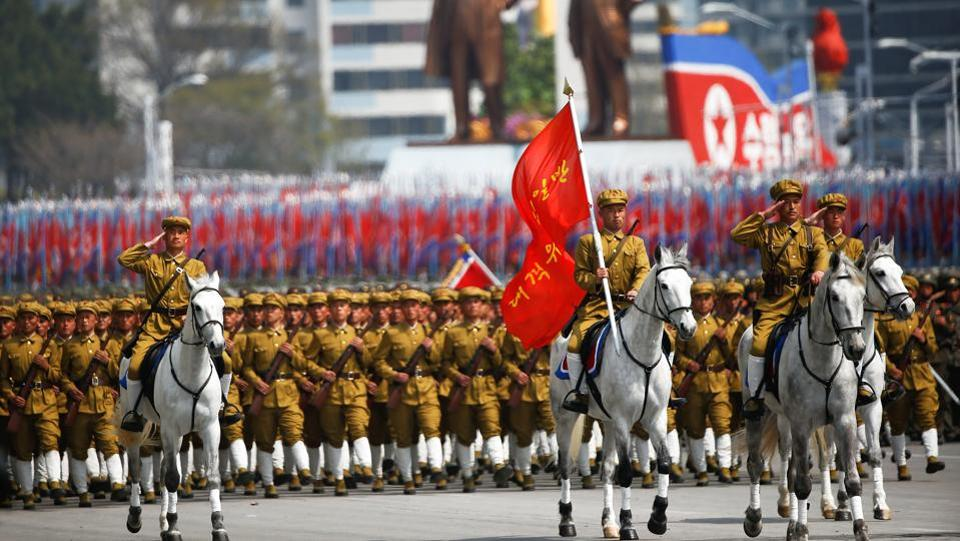 North Korean soldiers, some of them on horses, march during a military parade. (Damir Sagolj / REUTERS)