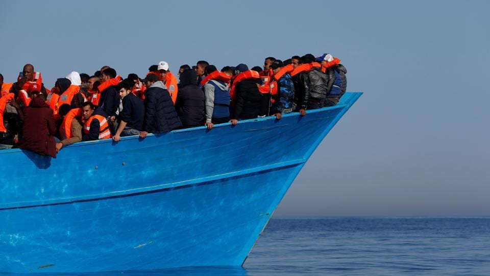Migrants on a wooden boat await rescue by the Malta-based NGO Migrant Offshore Aid Station (MOAS) in the central Mediterranean in international waters off the coast of Sabratha in Libya, April 15.