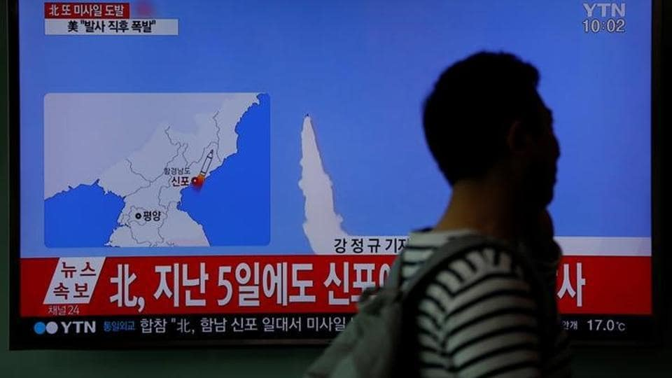 A passenger walks past a TV broadcasting a news report on North Korea's failed missile launch from its east coast, at a railway station in Seoul, South Korea on April 16.