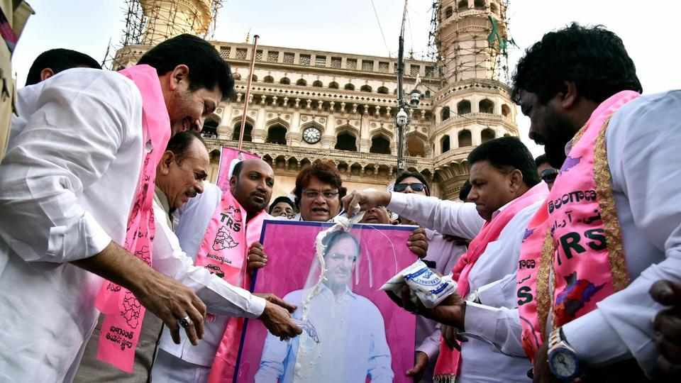 Deputy CM Mohammed Mahmood Ali and Waqf board chairman Mohammed Saleem along with party workers pour milk on a portrait of Telangana chief minister K Chandrashekhar Rao for pushing reservation for Muslims to 12%, at Charminar in Hyderabad on Thursday.