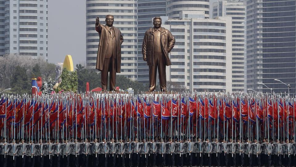 University students carry the national flag and two bronze statues of the late leaders Kim Il Sung and Kim Jong Il during a military parade. (Wong Maye-E / AP)