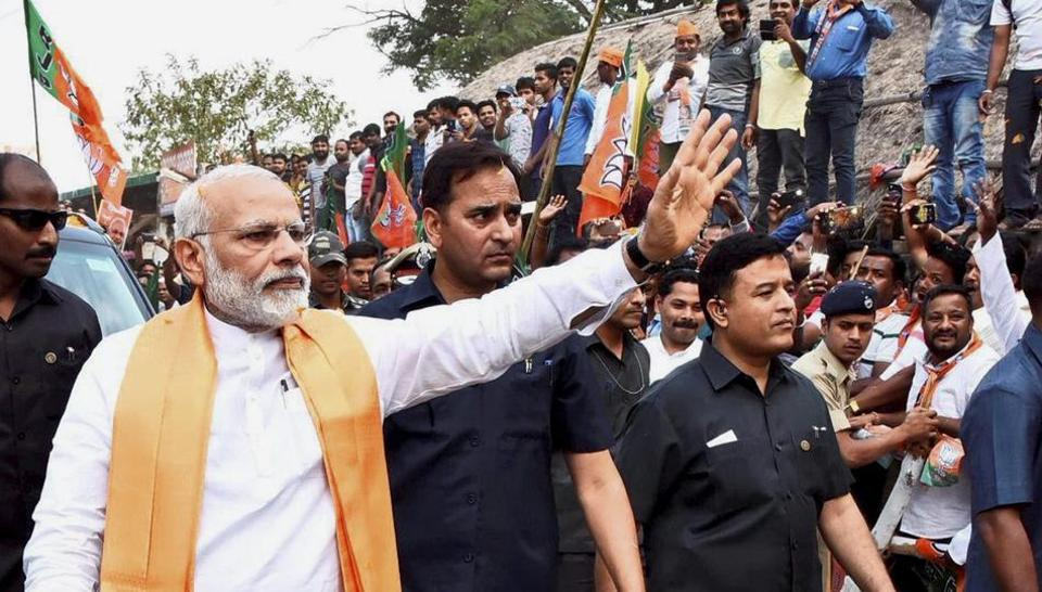 Prime Minister Narendra Modi greets supporters during his visit to Lord Lingaraj temple in Bhubaneswar on Sunday. He spoke about the need to reach out to backward Muslims during BJP's national executive meet.