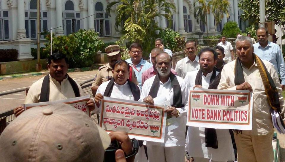 BJP lawmakers protest against the Telangana government for passing a bill to hike reservation for Scheduled Tribes and Muslims, in Hyderabad on Sunday. PTI Photo.