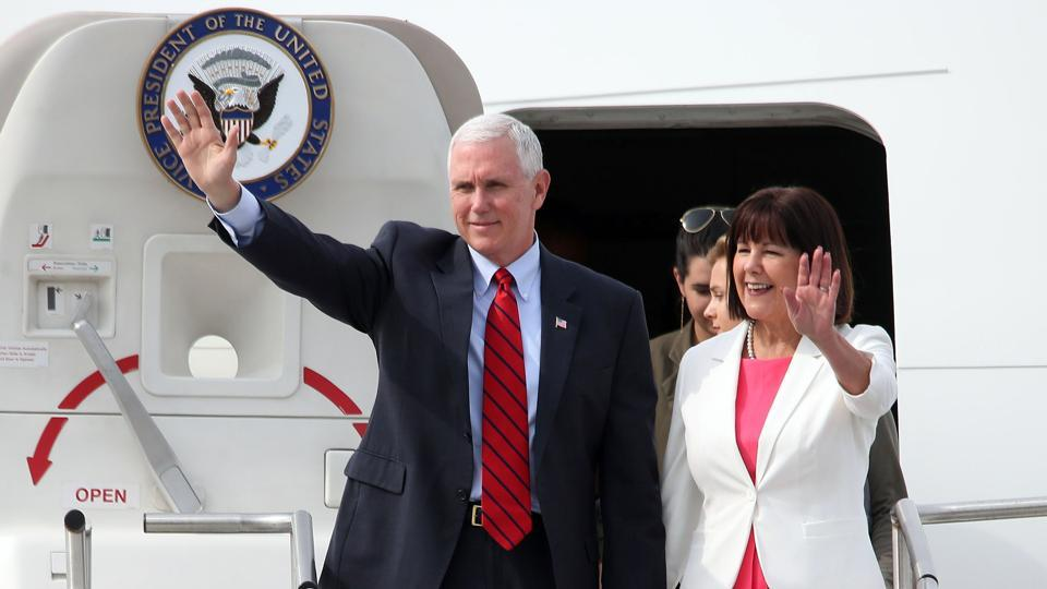 US Vice President Mike Pence and his wife Karen Pence wave as they arrive at the US Osan Air Base in Pyeongtaeck on April 16, 2017. Pence arrived in South Korea for a three-days visit where the nuclear issue will be top of the agenda at talks with South Korea's acting president Hwang Kyo-Ahn.