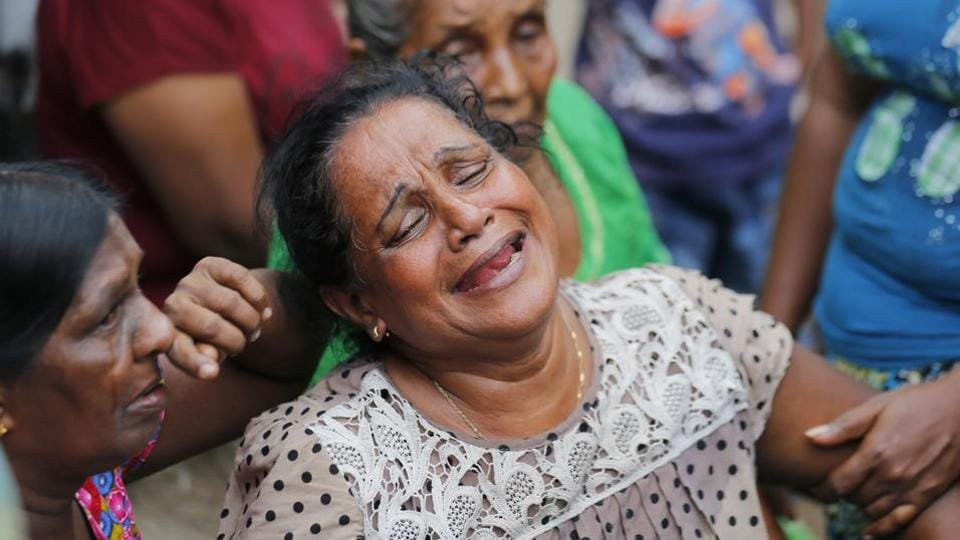 A Sri Lankan woman who lost her family members in a garbage dump collapse cries in Meetotamulla, on the outskirts of Colombo. (Eranga Jayawardena/ AP)