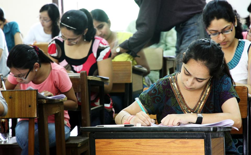 Students taking a postgraduate exam at Delhi University's North Campus.  Candidates taking a postgraduate exam at Delhi University's North Campus. More than two crore students in the country appear in Class 10 and around 1.5 crore in Class 12 exams conducted by more than 40 education boards.