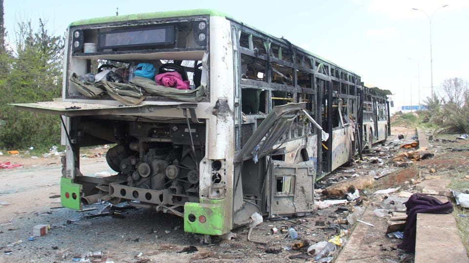 A picture taken on April 16, 2017, shows the damage a day after a suicide car bombing attack in Rashidin, west of Aleppo, targeted busses carrying Syrians evacuated from two besieged government-held towns of Fuaa and Kafraya.