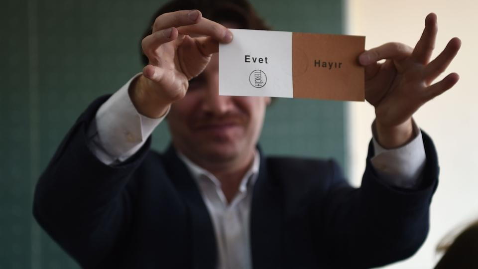 An electoral official shows a