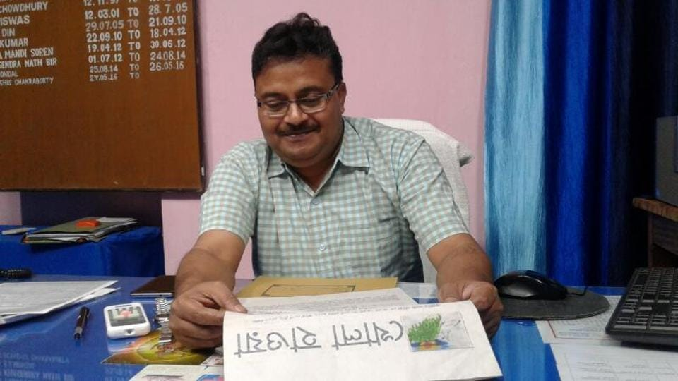 Midnapore jail super Debasish Chakraborty with a copy of the Bengali magazine, the first issue of which was published on Bengali New Year day on April 14.