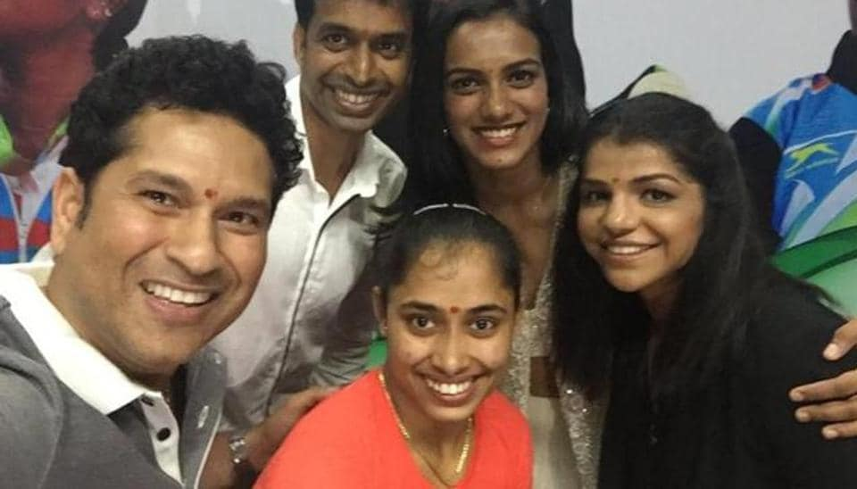 Sachin Tendulkar with badminton coach Gopichand and  Olympians PV Sindhu, Sakshi Malik (R), Deepa Karmakar (Centre below). Both Malik and Karmakar feature in the Forbes 50 Indians' list of under 30 super achievers.