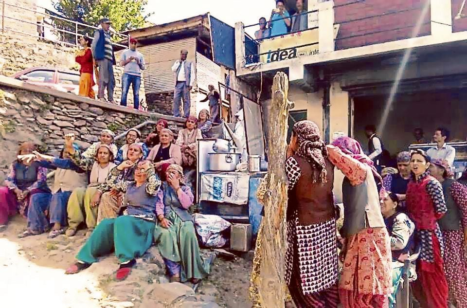 Women protesting against a liquor vend in Kotkhai on Monday.