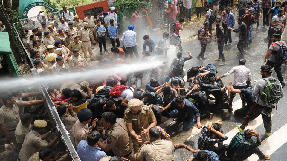 Violence was rampant at the Panjab University campus on April 11, with students resorting to stone-pelting while police forces used tear gas and water cannons.