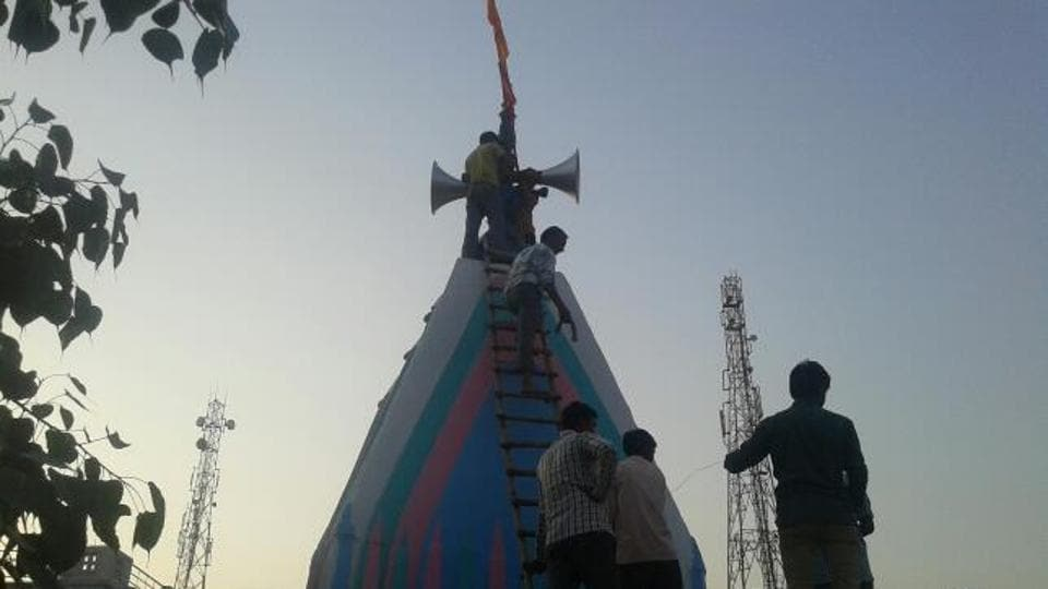 A loudspeaker being installed at the Shiv Temple in the village on Sunday.
