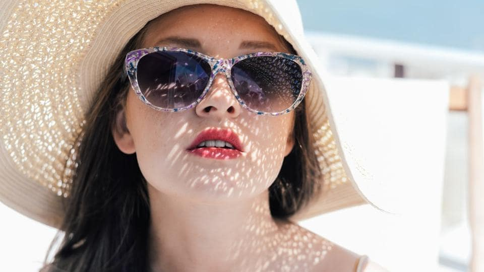 Wear sun-protective clothing, such as a broad-brimmed hat, long-sleeved cotton or linen shirt and pants.