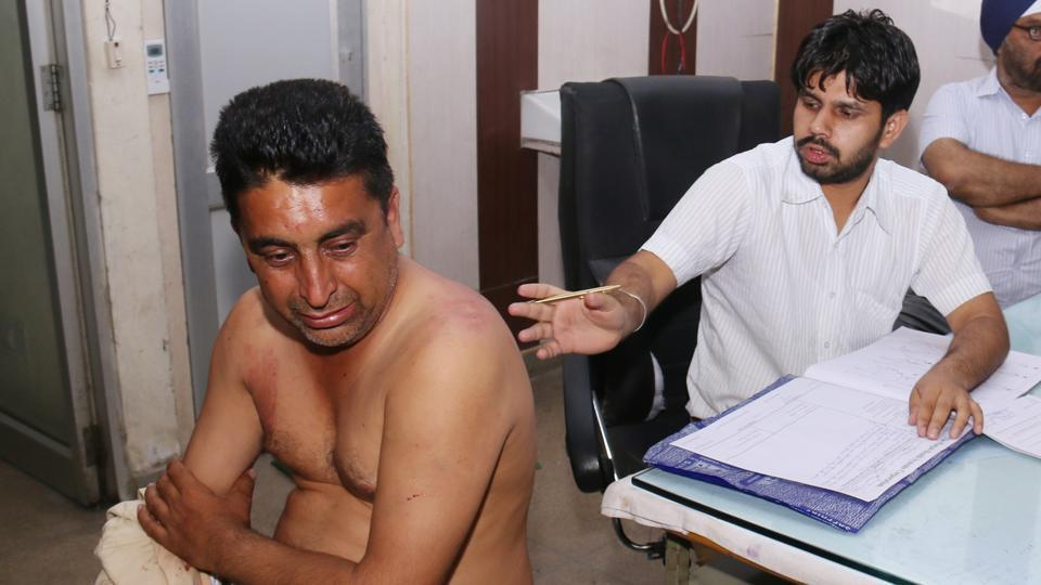 Shivraj Singh Raju (left) under treatment at the civil hospital in Bathinda on Saturday, April 15.